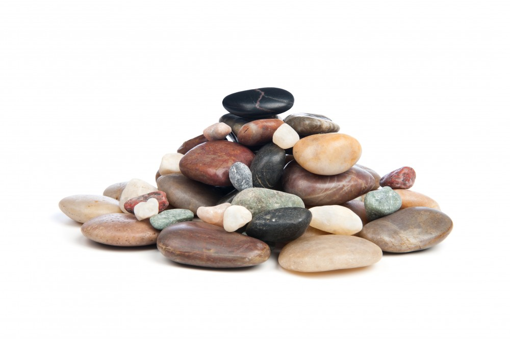 A pile of smooth, shiny river rocks on a white background.