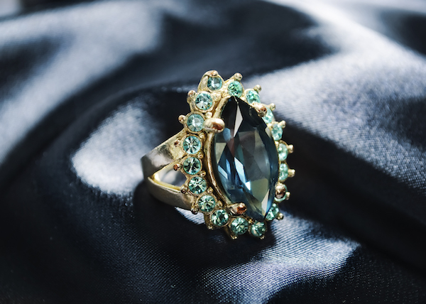Diamond ring on blue silk